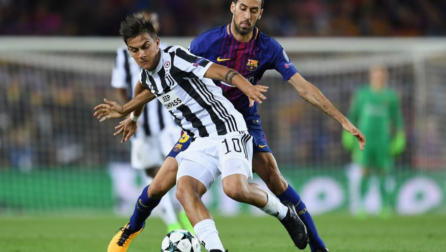 BARCELONA, SPAIN - SEPTEMBER 12:  Paulo Dybala of Juventus and Sergio Busquets of Barcelona battle for possession during the UEFA Champions League Group D match between FC Barcelona and Juventus at Camp Nou on September 12, 2017 in Barcelona, Spain.  (Photo by David Ramos/Getty Images)