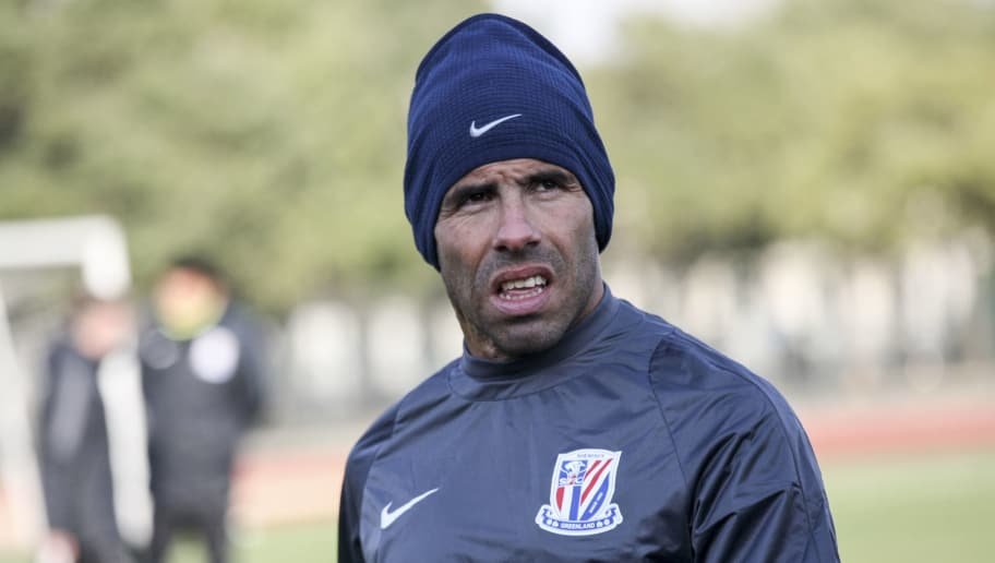 Argentine striker Carlos Tevez takes part in his first training session with his new club Shanghai Shenhua in Shanghai on January 21, 2017. / AFP / STR / China OUT        (Photo credit should read STR/AFP/Getty Images)