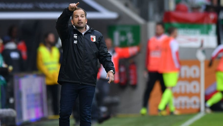 AUGSBURG, GERMANY - SEPTEMBER 09: Head coach Manuel Baum of Augsburg gestures during the Bundesliga match between FC Augsburg and 1. FC Koeln at WWK-Arena on September 9, 2017 in Augsburg, Germany. (Photo by Sebastian Widmann/Bongarts/Getty Images)