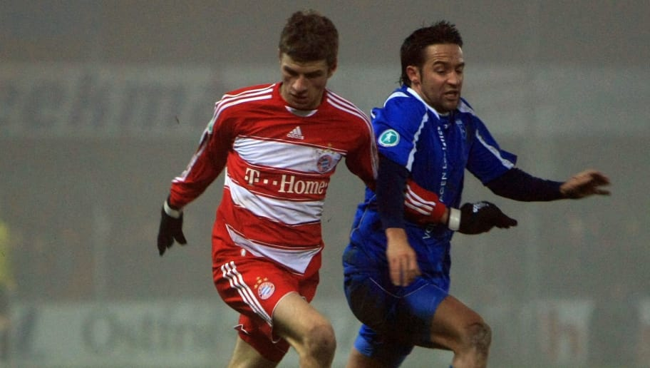 EMDEN, GERMANY - DECEMBER 16: Thomas Mueller (L) and Tom Moosmayer compete for the ball during the 3rd Bundesliga match between Kickers Emden and FC Bayern Muenchen at the Embdena stadium on December 16, 2008 in Emden, Germany. (Photo  by Martin Stoever /Bongarts/Getty Images for DFB)