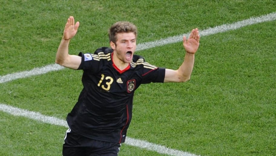 Germany's midfielder Thomas Mueller celebrates after scoring the opening goal during the 2010 World Cup quarter-final football match Argentina vs. Germany on July 3, 2010 at Green Point stadium in Cape Town.  NO PUSH TO MOBILE / MOBILE USE SOLELY WITHIN EDITORIAL ARTICLE -      AFP PHOTO / PIERRE-PHILIPPE MARCOU (Photo credit should read PIERRE-PHILIPPE MARCOU/AFP/Getty Images)