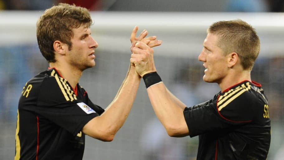 Germany's midfielder Thomas Mueller (L) and Germany's midfielder Bastian Schweinsteiger celebrate after the quarter final 2010 World Cup match Argentina versus Germany on July 3, 2010 at Green Point Stadium in Cape Town. Germany won the match 4-0. NO PUSH TO MOBILE / MOBILE USE SOLELY WITHIN EDITORIAL ARTICLE - AFP PHOTO / DANIEL GARCIA (Photo credit should read DANIEL GARCIA/AFP/Getty Images)