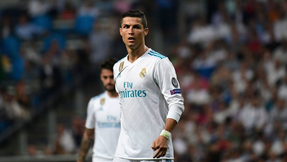 Real Madrid's forward from Portugal Cristiano Ronaldo looks on during the UEFA Champions League football match Real Madrid CF vs APOEL FC at the Santiago Bernabeu stadium in Madrid on September 13, 2017. / AFP PHOTO / PIERRE-PHILIPPE MARCOU        (Photo credit should read PIERRE-PHILIPPE MARCOU/AFP/Getty Images)