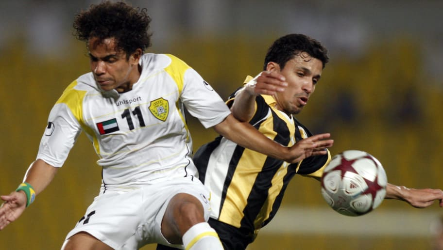 UAE's Al-Wasl club Brazilian footballer Elton Jose Xavier Gomes (L) vies with Jassem al-Buainan (R) of Qatar club during their first leg of the GCC Clubs Championship final in Doha on April 13, 2010. The match ended in a 2-2 draw. AFP PHOTO/KARIM JAAFAR (Photo credit should read KARIM JAAFAR/AFP/Getty Images)