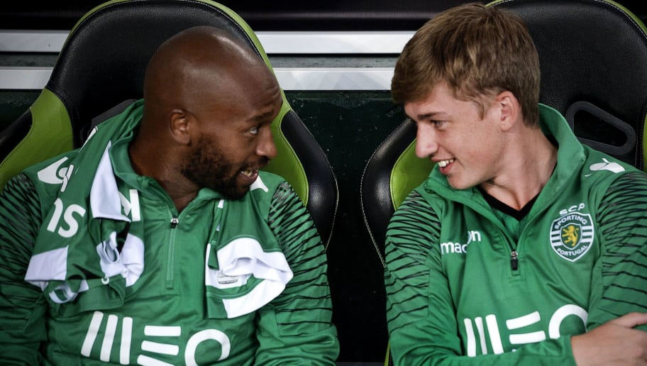 Sporting's Scottish midfielder Ryan Gauld (R) chats with Sporting's Egyptian forward Mahmoud Shikabala prior to the Violinos Cup football match between Sporting and Lazio at Alvalade stadium in Lisbon on August 1, 2014.    AFP PHOTO/ PATRICIA DE MELO MOREIRA        (Photo credit should read PATRICIA DE MELO MOREIRA/AFP/Getty Images)