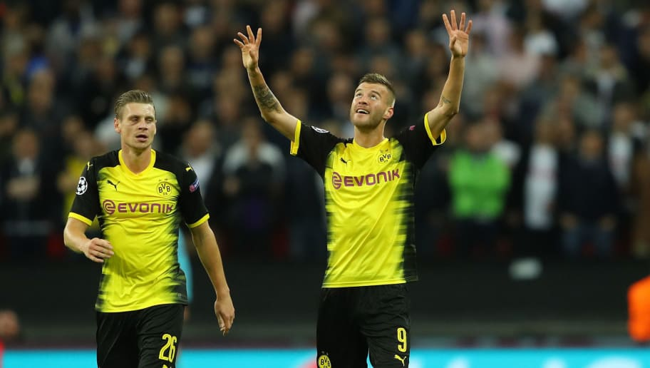 LONDON, ENGLAND - SEPTEMBER 13:  Andrey Yarmolenko of Borussia Dortmund celebrates scoring his sides first goal with Lukasz Piszczek of Borussia Dortmund during the UEFA Champions League group H match between Tottenham Hotspur and Borussia Dortmund at Wembley Stadium on September 13, 2017 in London, United Kingdom.  (Photo by Warren Little/Getty Images)