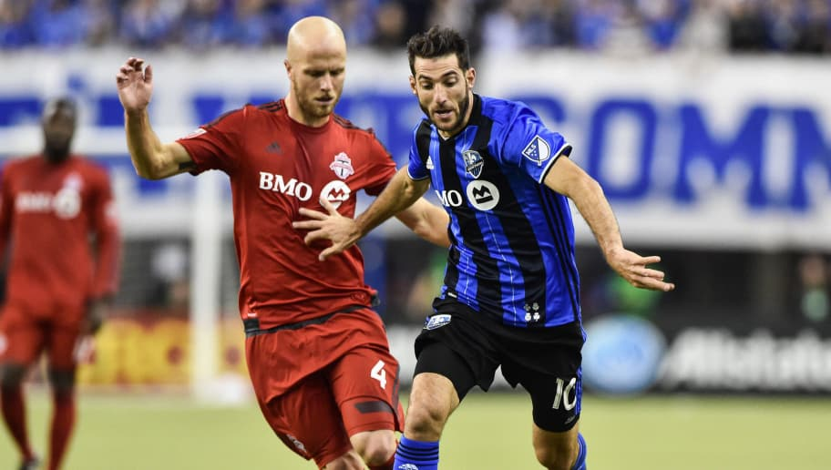 MONTREAL, QC - NOVEMBER 22:  Ignacio Piatti #10 of the Montreal Impact plays the ball past Michael Bradley #4 of the Toronto FC during leg one of the MLS Eastern Conference finals at Olympic Stadium on November 22, 2016 in Montreal, Quebec, Canada.  (Photo by Minas Panagiotakis/Getty Images)