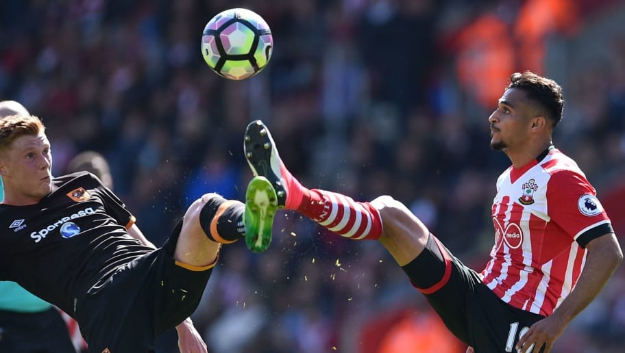 Hull City's English midfielder Sam Clucas (L) vies with Southampton's Moroccan midfielder Sofiane Boufal during the English Premier League football match between Southampton and Hull City at St Mary's Stadium in Southampton, southern England on April 29, 2017.  / AFP PHOTO / Glyn KIRK / RESTRICTED TO EDITORIAL USE. No use with unauthorized audio, video, data, fixture lists, club/league logos or 'live' services. Online in-match use limited to 75 images, no video emulation. No use in betting, games or single club/league/player publications.  /         (Photo credit should read GLYN KIRK/AFP/Getty Images)