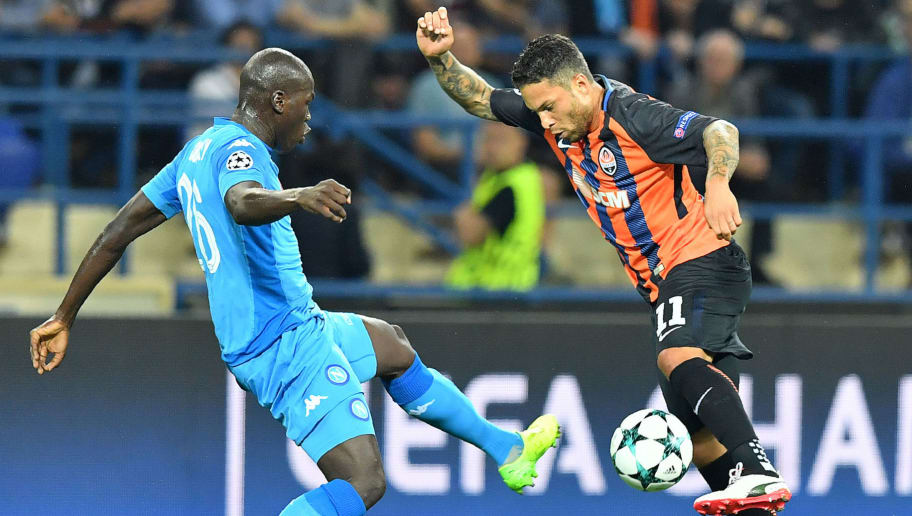 Shakhtar Donetsk's Brazilian midfielder Marlos (R) and SSC Napoli's Senegalese defender Kalidou Koulibaly vie for the ball during the UEFA Champions League Group F football match between FC Shakhtar Donetsk and SSC Napoli at The Metalist Stadium in Kharkiv on September 13, 2017. / AFP PHOTO / SERGEI SUPINSKY        (Photo credit should read SERGEI SUPINSKY/AFP/Getty Images)