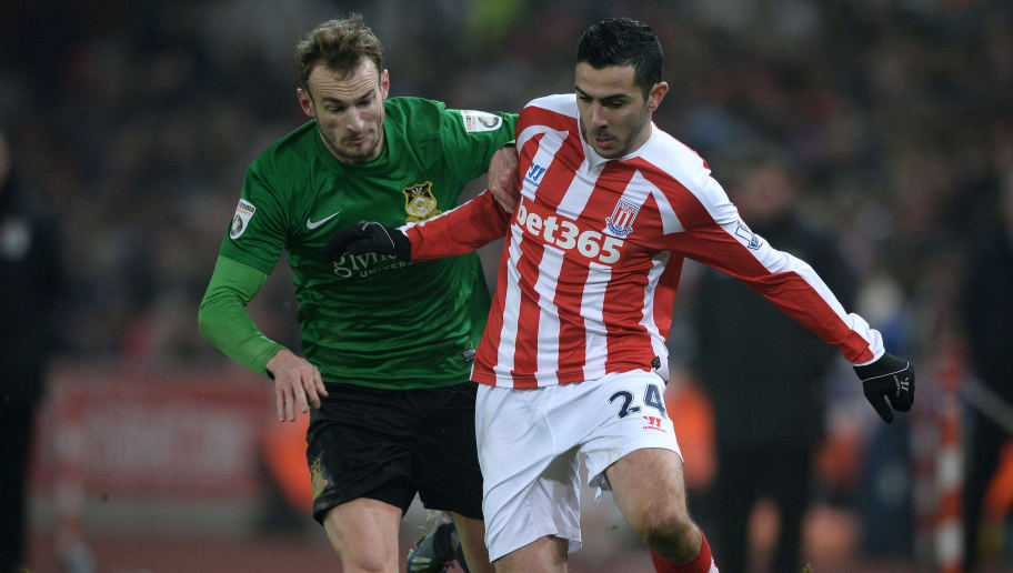 STOKE ON TRENT, ENGLAND - JANUARY 04:  Oussama Assaidi of Stoke City runs with the ball under pressure from Wes York of Wrexham during the FA Cup Third Round match between Stoke City and Wrexham at Britannia Stadium on January 4, 2015 in Stoke on Trent, England.  (Photo by Gareth Copley/Getty Images)