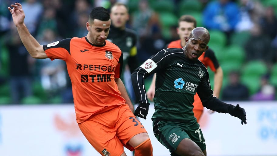 KRASNODAR, RUSSIA - NOVEMBER 20: Charles Kabore (R) of FC Krasnodar is challenged by Giorgi Chanturia of FC Ural Ekaterinburg during the Russian Premier League match between FC Krasnodar v FC Ural Ekaterinburg at Krasnodar Stadium on November 20, 2016 in Krasnodar, Russia. (Photo by Epsilon/Getty Images)