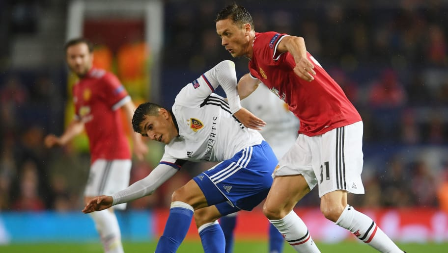 MANCHESTER, ENGLAND - SEPTEMBER 12: Mohamed Elyounoussi of FC Basel and Nemanja Matic of Manchester United battle for possession during the UEFA Champions League Group A match between Manchester United and FC Basel at Old Trafford on September 12, 2017 in Manchester, United Kingdom.  (Photo by Laurence Griffiths/Getty Images)