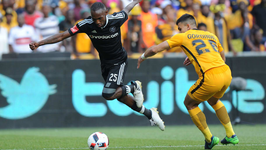 Thabo Rakhale of Orlando Pirates vies with Lorenzo Gordinho of Kaiser Chiefs during their derby football match on October 29, 2016 at the FNB Stadium in Johannesburg.  / AFP / STRINGER        (Photo credit should read STRINGER/AFP/Getty Images)