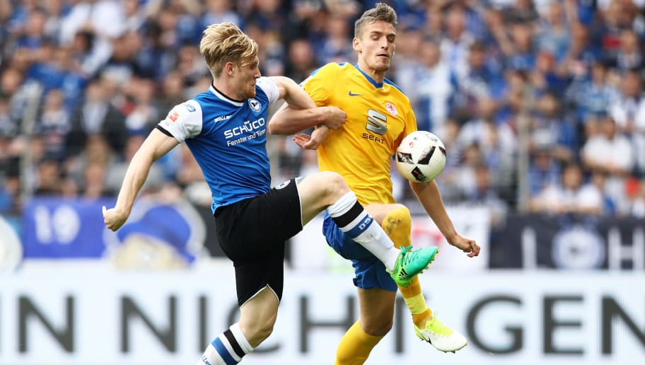 BIELEFELD, GERMANY - MAY 14:  Gustav Valsvik (R) of Braunschweig and Andreas Voglsammer (L) of Bielefeld compete for the ball during the Second Bundesliga match between DSC Arminia Bielefeld and Eintracht Braunschweig at Schueco Arena on May 14, 2017 in Bielefeld, Germany.  (Photo by Oliver Hardt/Bongarts/Getty Images)