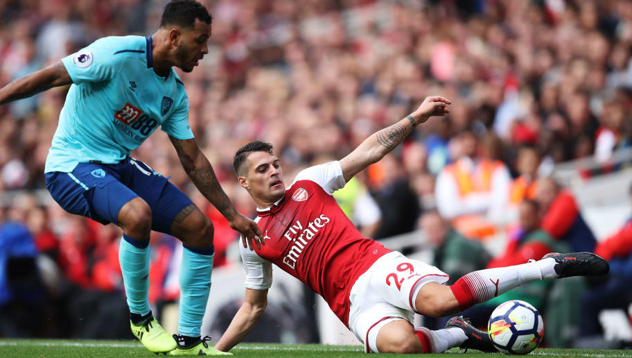 LONDON, ENGLAND - SEPTEMBER 09:  Joshua King of AFC Bournemouth and Granit Xhaka of Arsenal battle for possession during the Premier League match between Arsenal and AFC Bournemouth at Emirates Stadium on September 9, 2017 in London, England.  (Photo by Julian Finney/Getty Images)