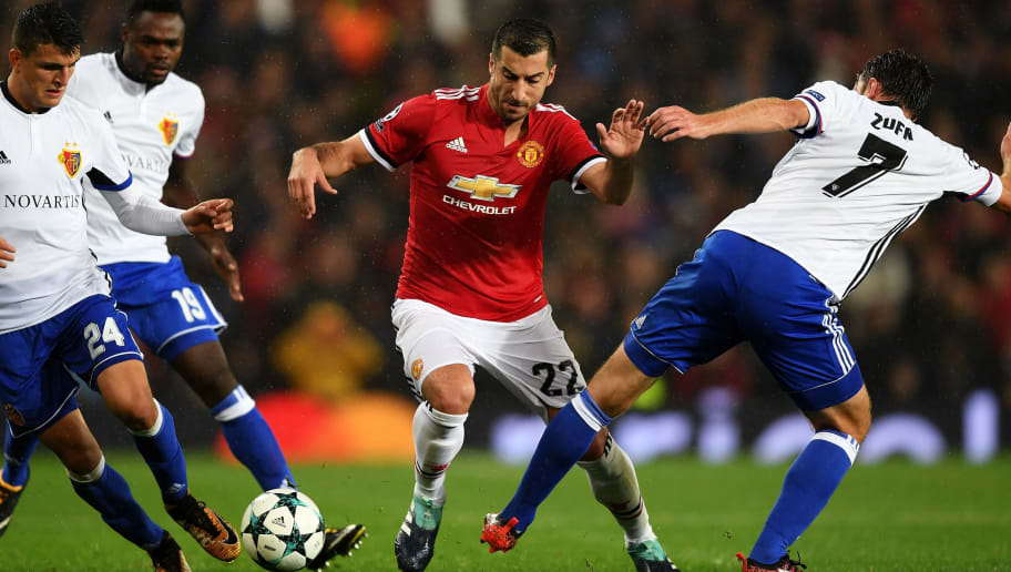 MANCHESTER, ENGLAND - SEPTEMBER 12: Henrikh Mkhitaryan of Manchester United attempts to get past Mohamed Elyounoussi of FC Basel and Luca Zuffi of FC Basel during the UEFA Champions League Group A match between Manchester United and FC Basel at Old Trafford on September 12, 2017 in Manchester, United Kingdom.  (Photo by Shaun Botterill/Getty Images)