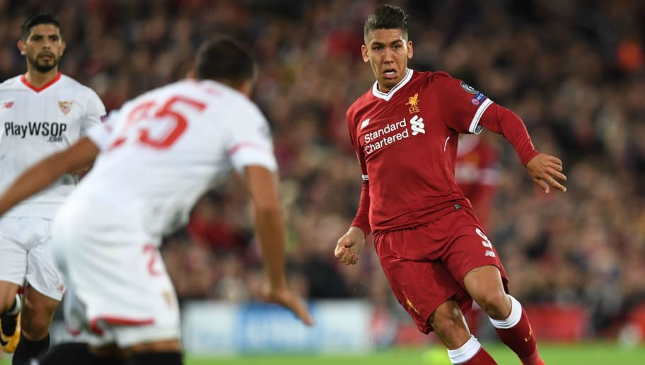 Liverpool's Brazilian midfielder Roberto Firmino dribbles during the UEFA Champions League Group E football match between Liverpool and Sevilla at Anfield in Liverpool, north-west England on September 13, 2017. / AFP PHOTO / Paul ELLIS        (Photo credit should read PAUL ELLIS/AFP/Getty Images)