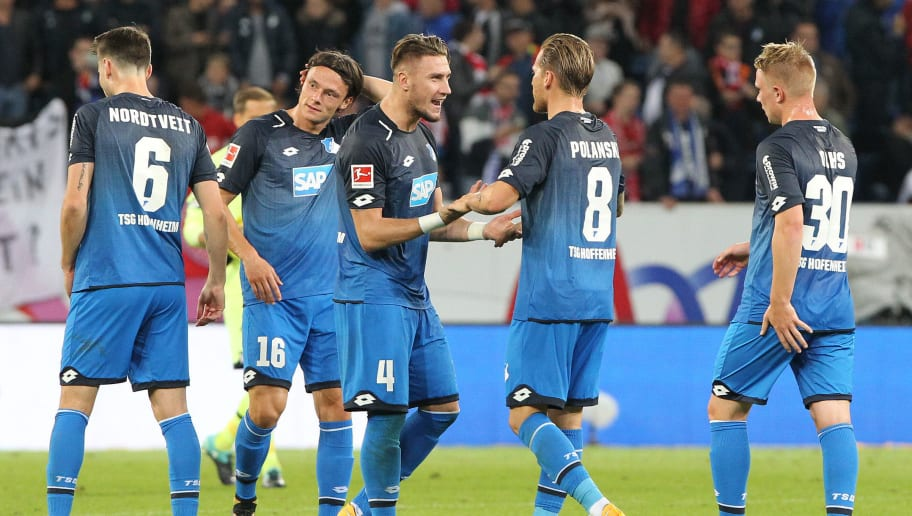 Hoffenheim's players celebrate the 2-0 victory during German first division Bundesliga football match between  TSG Hoffenheim and FC Bayern Munich in Sinsheim on September 9, 2017. / AFP PHOTO / Daniel ROLAND / RESTRICTIONS: DURING MATCH TIME: DFL RULES TO LIMIT THE ONLINE USAGE TO 15 PICTURES PER MATCH AND FORBID IMAGE SEQUENCES TO SIMULATE VIDEO. == RESTRICTED TO EDITORIAL USE == FOR FURTHER QUERIES PLEASE CONTACT DFL DIRECTLY AT + 49 69 650050  / RESTRICTIONS: DURING MATCH TIME: DFL RULES TO LIMIT THE ONLINE USAGE TO 15 PICTURES PER MATCH AND FORBID IMAGE SEQUENCES TO SIMULATE VIDEO. == RESTRICTED TO EDITORIAL USE == FOR FURTHER QUERIES PLEASE CONTACT DFL DIRECTLY AT + 49 69 650050        (Photo credit should read DANIEL ROLAND/AFP/Getty Images)