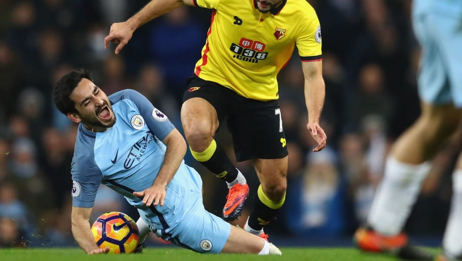 MANCHESTER, ENGLAND - DECEMBER 14:   Ilkay Gundogan of Manchester City is fouled by Nordin Amrabat of Watford leading to Gundogan being substituted through injury during the Premier League match between Manchester City and Watford at the Etihad Stadium on December 14, 2016 in Manchester, England.  (Photo by Michael Steele/Getty Images)