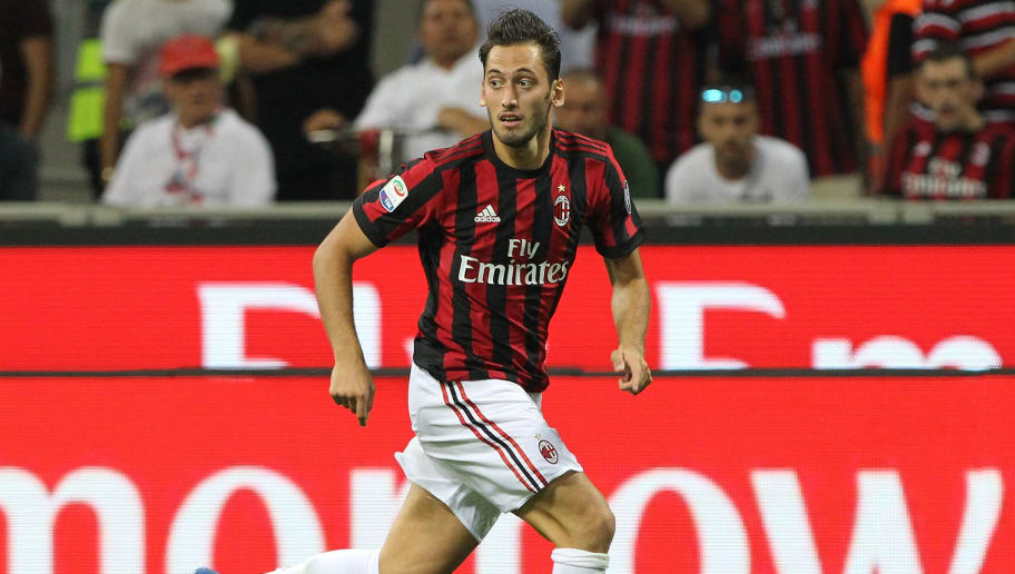 MILAN, ITALY - AUGUST 27:  Hakan Calhanoglu of AC Milan in action during the Serie A match between AC Milan and Cagliari Calcio at Stadio Giuseppe Meazza on August 27, 2017 in Milan, Italy.  (Photo by Marco Luzzani/Getty Images)