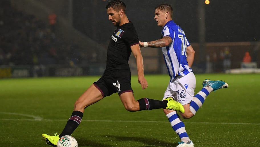 COLCHESTER, ENGLAND - AUGUST 09:  Conor Hourihane of Aston Villa shoots at goal as he is challenged by James Bree of Colchester during the Carabao Cup First Round match between Colchester United and Aston Villa at Colchester Community Stadium on August 9, 2017 in Colchester, England.  (Photo by Mike Hewitt/Getty Images)