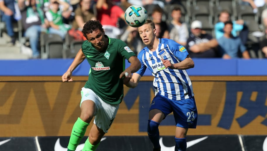 BERLIN, GERMANY - SEPTEMBER 10:  Mitchell Weiser (R) of Berlin battles for the ball with Milos Veljkovic of Bremen during the Bundesliga match between Hertha BSC and SV Werder Bremen at Olympiastadion on September 10, 2017 in Berlin, Germany. (Photo by Matthias Kern/Bongarts/Getty Images)