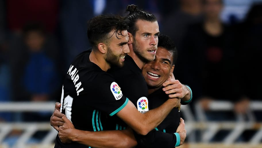 SAN SEBASTIAN, SPAIN - SEPTEMBER 17:  Gareth Bale of Real Madrid CF (C) celebrates with his team mates Borja Mayoral (L) and Carlos Enrique Casimiro after scoring his team's third goal during the La Liga match between Real Sociedad and Real Madrid at Anoeta stadium on September 17, 2017 in San Sebastian, Spain.  (Photo by David Ramos/Getty Images)