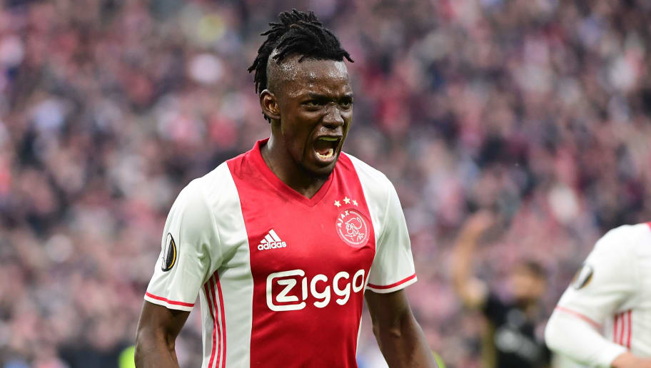 Ajax forward Bertrand Traoré (C) reacts after fourth goal during UEFA Europa League semi-final, first leg, Ajax Amsterdam v Olympique Lyonnais on May 3, 2017 in Amsterdam.  / AFP PHOTO / Emmanuel DUNAND        (Photo credit should read EMMANUEL DUNAND/AFP/Getty Images)