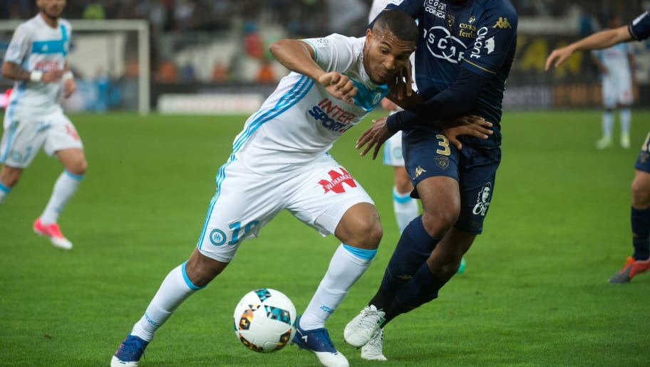 Marseille's French midfielder William Vainqueur (L) vies with Bastia's French defender Nicolas Saint-Ruf during the French L1 football match Olympique de Marseille vs Bastia on May 20, 2017 at the Velodrome stadium in Marseille, southern France. BERTRAND LANGLOIS / AFP / AFP PHOTO / BERTRAND LANGLOIS        (Photo credit should read BERTRAND LANGLOIS/AFP/Getty Images)