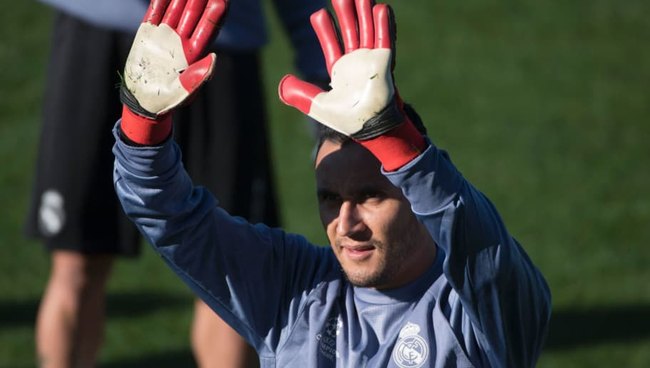 Real Madrid's Costa Rican goalkeeper Keylor Navas gestures as he attends a training session on the eve of the UEFA Champions league football match Real Madrid vs Borussia Dortmund at the Real Madrid's training ground of Valdebebas in Madrid on December 6, 2016. / AFP / CURTO DE LA TORRE        (Photo credit should read CURTO DE LA TORRE/AFP/Getty Images)