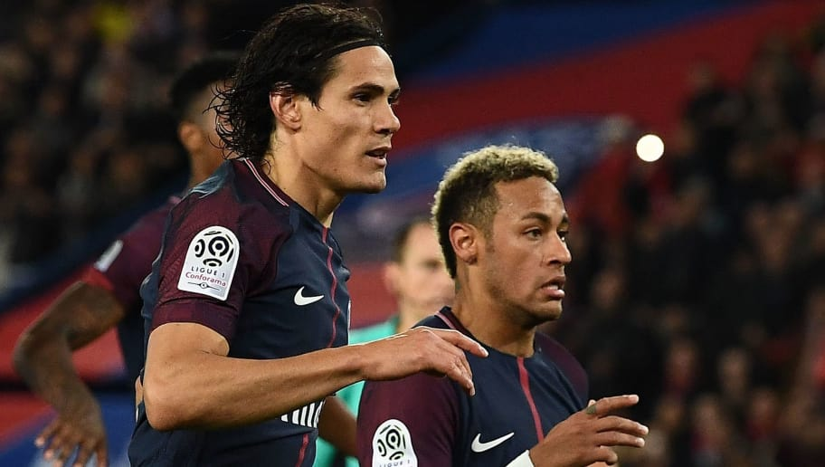 Paris Saint-Germain's Uruguayan forward Edinson Cavani (L) and Paris Saint-Germain's Brazilian forward Neymar react after a penalty during the French Ligue 1 football match between Paris Saint-Germain (PSG) and Lyon (OL) on September 17, 2017 at the Parc des Princes stadium in Paris. / AFP PHOTO / FRANCK FIFE        (Photo credit should read FRANCK FIFE/AFP/Getty Images)