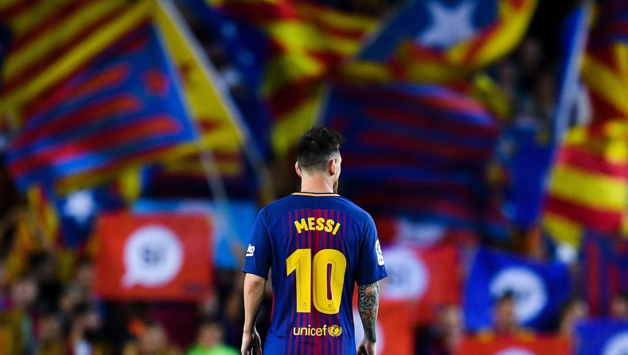 BARCELONA, SPAIN - SEPTEMBER 19:  Lionel Messi of FC Barcelona looks on as Catalan Pro-Independence flags are seen on the background during the La Liga match between Barcelona and SD Eibar at Camp Nou on September 19, 2017 in Barcelona, Spain.  (Photo by David Ramos/Getty Images)