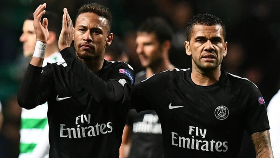 Paris Saint-Germain's Brazilian striker Neymar (L) and Paris Saint-Germain's Brazilian defender Dani Alves celebrate their win on the pitch after the UEFA Champions League Group B football match between Celtic and Paris Saint-Germain (PSG) at Celtic Park in Glasgow, on September 12, 2017. PSG won the game 5-0. / AFP PHOTO / Franck FIFE        (Photo credit should read FRANCK FIFE/AFP/Getty Images)