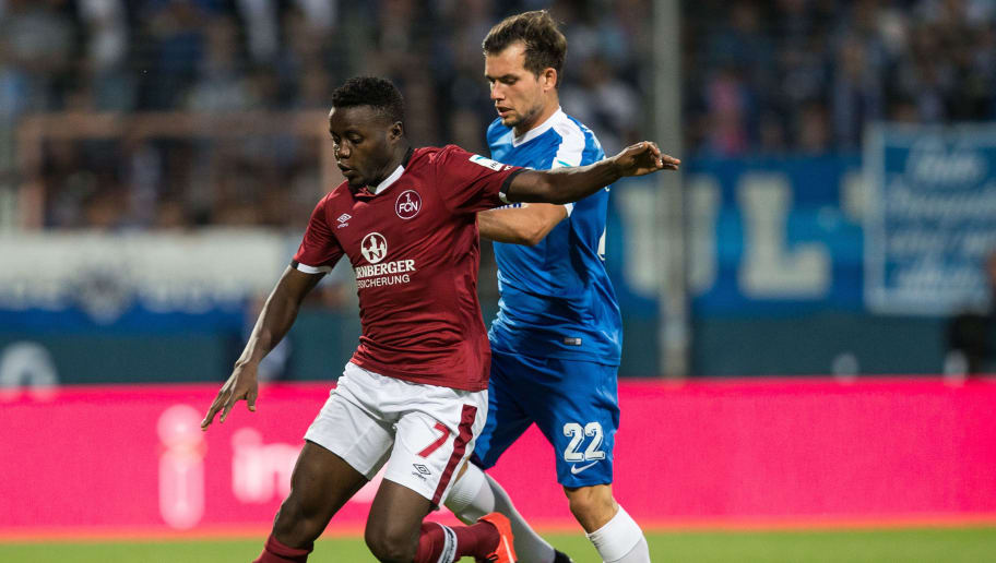 BOCHUM, GERMANY - SEPTEMBER 16:  Edgar Salli (L) of Nuernberg is challenged by Kevin Stoeger of Bochum during the Second Bundesliga match between VfL Bochum 1848 and 1. FC Nuernberg at Vonovia Ruhrstadion on September 16, 2016 in Bochum, Germany. (Photo by Maja Hitij/Bongarts/Getty Images)