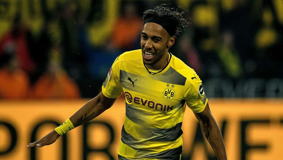 Dortmund's Gabonese forward Pierre-Emerick Aubameyang celebrates scoring during the German first division Bundesliga football match Borussia Dortmund v FC Cologne, in Dortmund, western Germany, on September 17, 2017. / AFP PHOTO / SASCHA SCHUERMANN / RESTRICTIONS: DURING MATCH TIME: DFL RULES TO LIMIT THE ONLINE USAGE TO 15 PICTURES PER MATCH AND FORBID IMAGE SEQUENCES TO SIMULATE VIDEO. == RESTRICTED TO EDITORIAL USE == FOR FURTHER QUERIES PLEASE CONTACT DFL DIRECTLY AT + 49 69 650050         (Photo credit should read SASCHA SCHUERMANN/AFP/Getty Images)