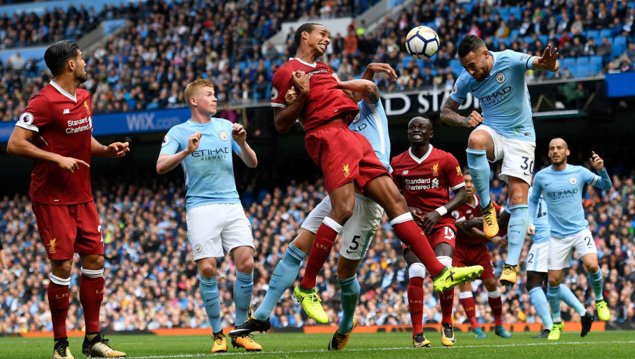 MANCHESTER, ENGLAND - SEPTEMBER 09: Nicolas Otamendi of Manchester City heads the ball clear during the Premier League match between Manchester City and Liverpool at Etihad Stadium on September 9, 2017 in Manchester, England.  (Photo by Stu Forster/Getty Images)