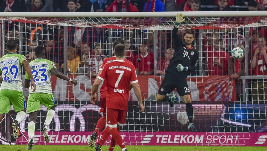 Bayern Munich's German keeper Sven Ulreich (R) fails to save the ball during the German First division Bundesliga football match FC Bayern Munich vs VfL Wolfsburg in Munich, southern Germany, on September 22, 2017. / AFP PHOTO / Guenter SCHIFFMANN / RESTRICTIONS: DURING MATCH TIME: DFL RULES TO LIMIT THE ONLINE USAGE TO 15 PICTURES PER MATCH AND FORBID IMAGE SEQUENCES TO SIMULATE VIDEO. == RESTRICTED TO EDITORIAL USE == FOR FURTHER QUERIES PLEASE CONTACT DFL DIRECTLY AT + 49 69 650050         (Photo credit should read GUENTER SCHIFFMANN/AFP/Getty Images)