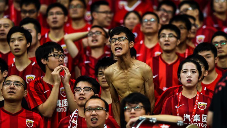 a6fb82e30 Shanghai Shenhua shout slogans during the 2017 Chinese Super League  football match between Shanghai East Asia