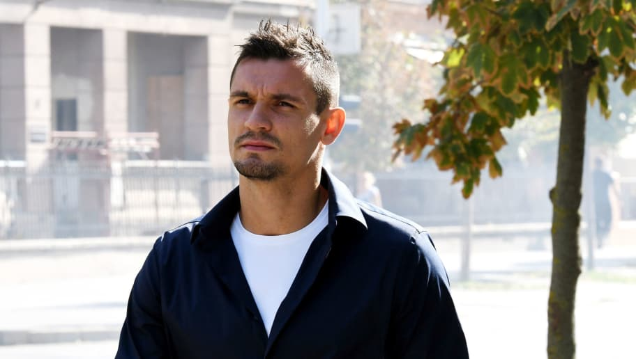 Liverpool's Croatian defender Dejan Lovren arrives at a tribunal in the eastern Croatian town of Osijek on September 1, 2017 to testify in a multi-million-euro corruption trial against Dinamo Zagreb's ex-chairman.  Zdravko Mamic, considered the most powerful man in Croatian football, is being tried along with his brother and former Dinamo Zagreb coach Zoran Mamic, former club director Damir Vrbanovic, and a tax inspector. / AFP PHOTO / STRINGER        (Photo credit should read STRINGER/AFP/Getty Images)