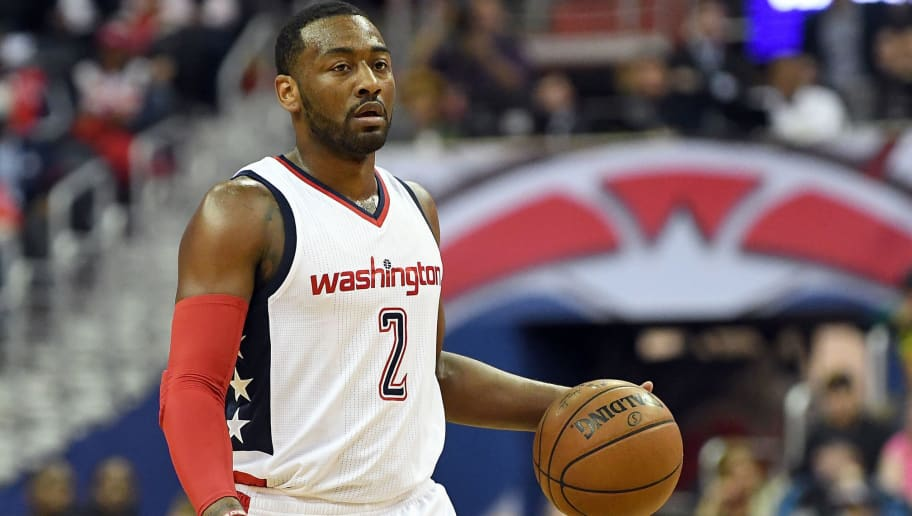 WASHINGTON, DC - MAY 04:  John Wall #2 of the Washington Wizards handles the ball against the Boston Celtics in Game Three of the Eastern Conference Semifinals at Verizon Center on May 4, 2017 in Washington, DC. NOTE TO USER: User expressly acknowledges and agrees that, by downloading and or using this photograph, User is consenting to the terms and conditions of the Getty Images License Agreement.  (Photo by Greg Fiume/Getty Images)