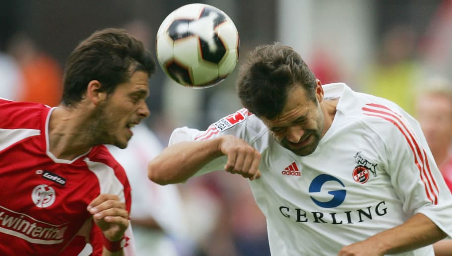 COLOGNE, GERMANY - AUGUST 06: Manuel Friedrich of Mainz (L) and Attila Tokoli of Cologne vie for a header during the Bundesliga match between 1.FC Cologne and FSV Mainz 05 at the RheinEnergie Stadium on August 6, 2005 in Cologne, Germany.  (Photo by Vladimir Rys/Bongarts/Getty Images)