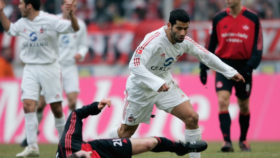 COLOGNE, GERMANY - MARCH 11: Markus Schroth of Nuremberg tackles Dimiotrios Grammozis of Colgne during the Bundesliga match between 1. FC Cologne and 1. FC Nuremberg at the Rhein Energie Stadium on March 11, 2006 in Cologne, Germany. (Photo by Christof Koepsel/Bongarts/Getty Images)