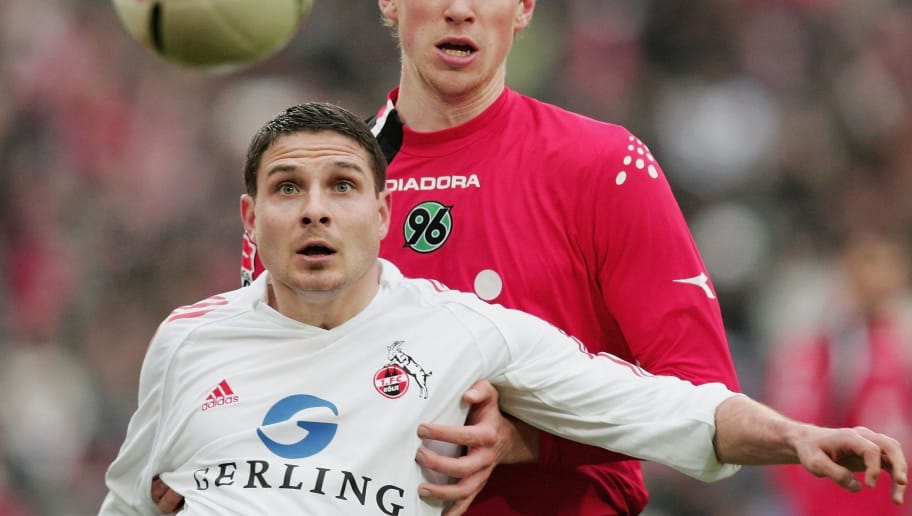 HANOVER, GERMANY - MARCH 18: Imre Szabics (L) of Koeln and Per Mertesacker (R) of Hannover vies for the ball  during the Bundesliga match between Hanover 96 and 1.FC Cologne at the AWD Arena on March 18, 2006 in Hanover, Germany.  (Photo by Martin Rose/Bongarts/Getty Images)
