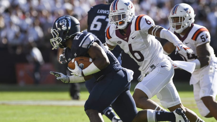 BLACKSBURG, VA - SEPTEMBER 23: Running back Brandon Simmons #23 of the Old Dominion University Monarchs carries the ball while being pursued by defensive back Mook Reynolds #6 of the Virginia Tech Hokies in the second half at Lane Stadium on September 23, 2017 in Blacksburg, Virginia. Virginia Tech defeated Old Dominion 38-0 (Photo by Michael Shroyer/Getty Images)