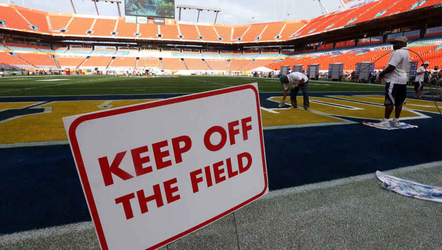 MIAMI GARDENS, FL - JANUARY 05:  A logo is painted in the endzone by a worker during Media Day ahead of the Discover BCS National Championship at Sun Life Stadium on January 5, 2013 in Miami Gardens, Florida.  (Photo by Streeter Lecka/Getty Images)