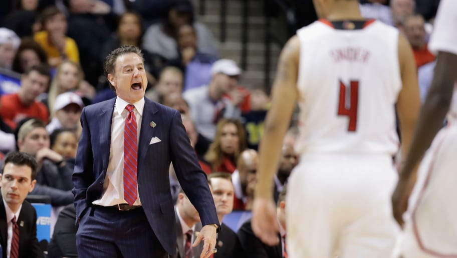 INDIANAPOLIS, IN - MARCH 19:  Head coach Rick Pitino of the Louisville Cardinals  reacts as Quentin Snider #4 looks on against the Michigan Wolverines in the first half during the second round of the 2017 NCAA Men's Basketball Tournament at the Bankers Life Fieldhouse on March 19, 2017 in Indianapolis, Indiana.  (Photo by Andy Lyons/Getty Images)