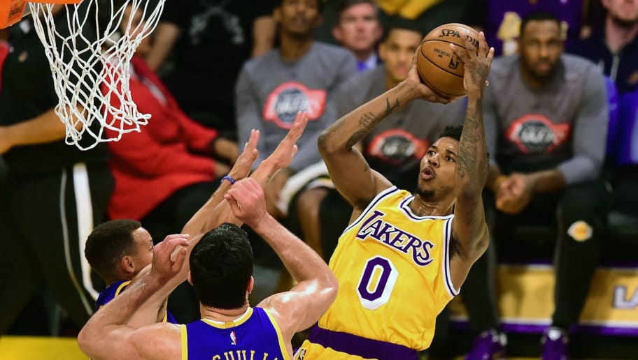 eb8b8daa58d5 Nick Young of Los Angeles Lakers shoots under pressure from Stephen Curry  and Zaza Pachulia of