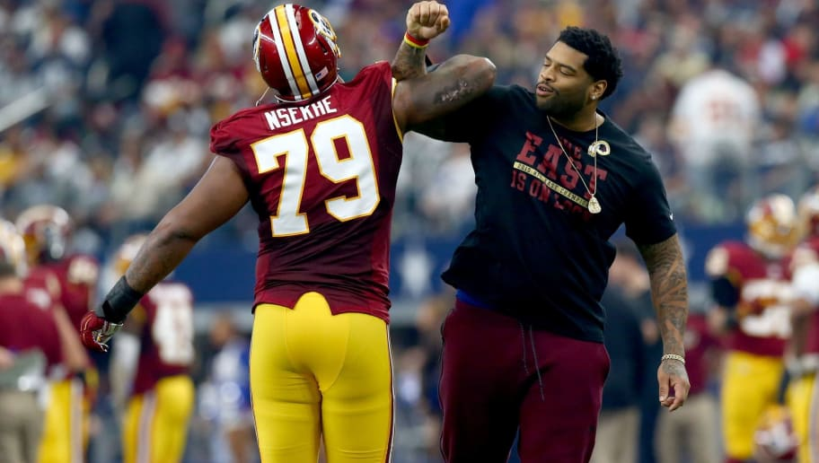 ARLINGTON, TX - JANUARY 03: Ty Nsekhe #79 of the Washington Redskins celebrates during the first half at AT&T Stadium on January 3, 2016 in Arlington, Texas. (Photo by Ronald Martinez/Getty Images)