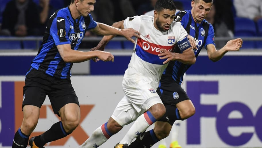 Lyon's French midfielder Nabil Fekir (C) vies with Atalanta's Swiss midfielder Remo Freuler (R) and Atalanta's Italian defender Mattia Caldara (L) during the Europa League football match between Olympique Lyonnais and Atalanta BC, on September 28, 2017 at the Groupama stadium in Lyon. / AFP PHOTO / PHILIPPE DESMAZES        (Photo credit should read PHILIPPE DESMAZES/AFP/Getty Images)