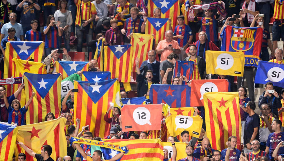 Catalan football fans hold Esteladas and flag reading 'Yes' before the Spanish league football match Girona FC vs FC Barcelona at the Montilivi stadium in Girona on September 23, 2017. Spain's Prime Minister Mariano Rajoy asked Catalan separatist leaders today to own up they can't hold an outlawed independence referendum after a crackdown dealt them a serious blow this week. / AFP PHOTO / Josep LAGO        (Photo credit should read JOSEP LAGO/AFP/Getty Images)